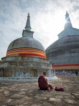 A monk praying in Anuradhapura